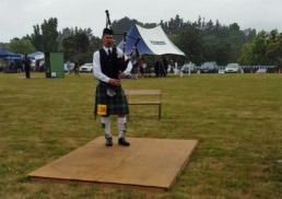 Andrew Ross competing in a piping competition